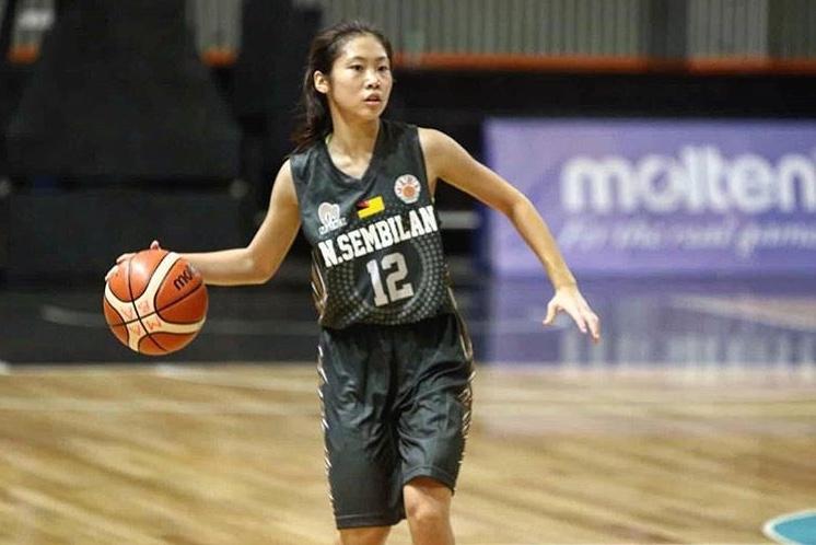 the girl playing basketball