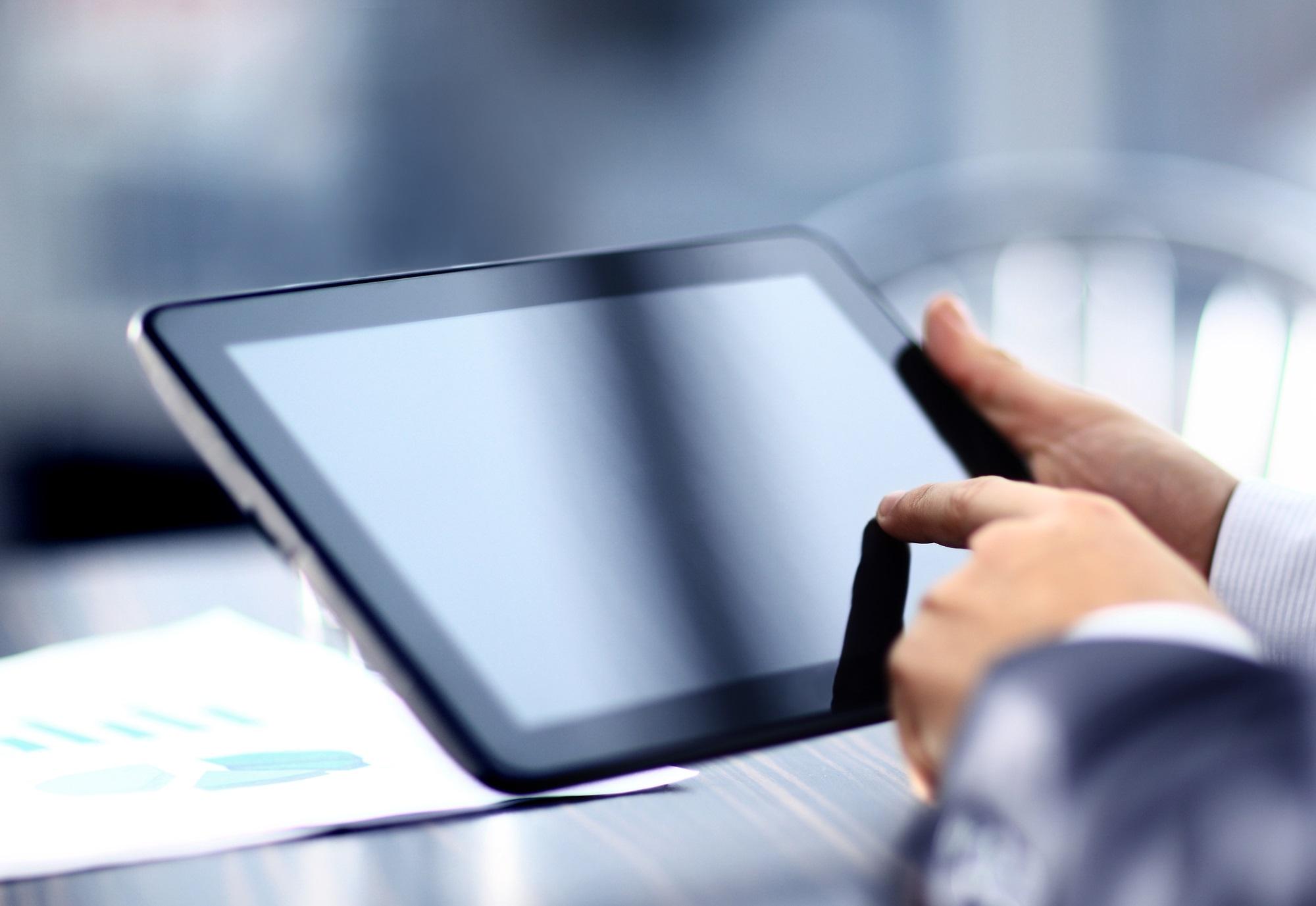 Teacher holding digital tablet