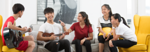 group of students playing guitar and having fun