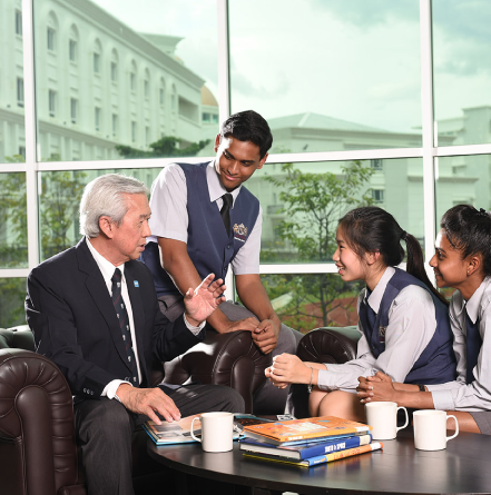 Teacher discussing with students