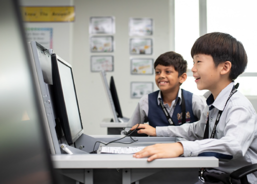 the two boys enjoy their computer class